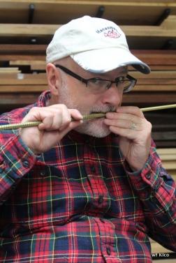 Bill removing string.