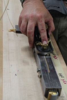 Planing to a fine tip. 6 narrow tips with come together to make the tip of the pole about the diameter of a toothpick.